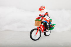 Miniature Santa Claus on bike Royalty Free Stock Image