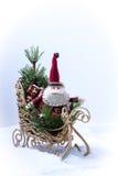 Miniature Santa Claus on a sleigh . Miniature Santa Claus on a sleigh with gifts Royalty Free Stock Image