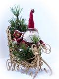 Miniature Santa Claus on a sleigh. Miniature Santa Claus on a sleigh with gifts Royalty Free Stock Photos