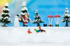 Miniature Santa Claus and Snow man make happy hour for children on Christmas day. Miniature Santa Claus and Snow man make happy hour for children on Christmas Royalty Free Stock Images