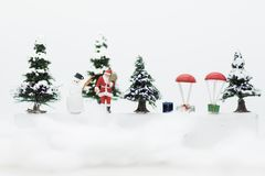 Miniature Santa Claus and Snow man make happy hour for children on Christmas day. Miniature Santa Claus and Snow man make happy hour for children on Christmas Stock Photography