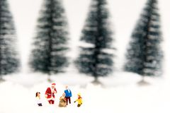 Miniature Santa Claus with Snow man make happy hour for children on Christmas day, Royalty Free Stock Images
