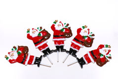 Miniature Santas. A photo taken on some Santa Claus figurine top decorations for cakes and pastries Royalty Free Stock Photo