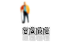 Miniature scale model pensioner with the word care Stock Images