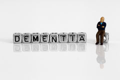 Miniature scale model pensioner with the word dementia Royalty Free Stock Photography