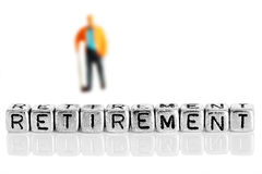 Miniature scale model pensioner with the word retirement Stock Photo