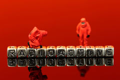 Miniature scale model team in chemical suits with the word radioactive Stock Images