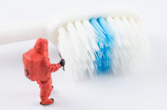 Miniature scientist checking bacteria on the toothbrush Stock Image