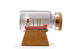 Miniature ship in small bottle Royalty Free Stock Photo