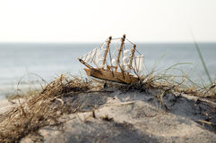 Miniature ship standing on sand Stock Photo