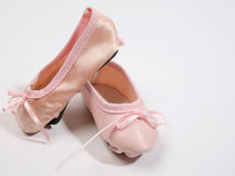 Miniature Shoes. One Leather and one satin ballet shoe Stock Photo