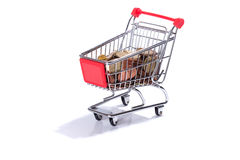 Miniature shopping cart with Euro coins, money Stock Image