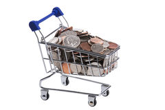 Miniature shopping cart filled with US coins isolated on a white background Stock Photos