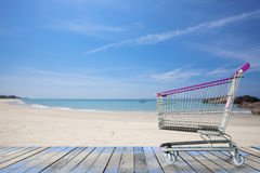 miniature shopping cart on tropical beach, for summer  shopping Stock Photo