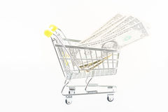Miniature shopping cart with US banknotes Stock Photography
