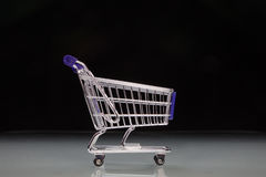 Miniature shopping trolley Stock Photography