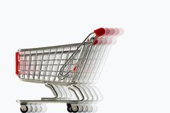 Fast Trolley. A miniature shopping trolley in fast moving effect using multiple layer image Stock Photos