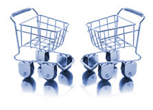 Miniature Shopping Trolleys. On White Background Royalty Free Stock Photography