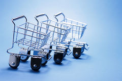 Miniature Shopping Trolleys Stock Photo
