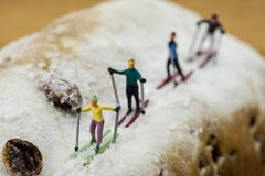 Miniature skier skiing on a cake. Concept Miniature skier skiing on a white cake Royalty Free Stock Photo
