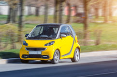 Miniature small city Smart car of yellow color. Russia, Saint-Petersburg, May 2017. Royalty Free Stock Image