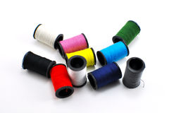 Miniature spools of thread of various colors Royalty Free Stock Photo