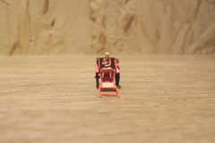 Miniature statue  and red vintage oriental rickshaw cab Royalty Free Stock Photo