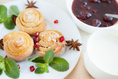 Miniature sugar biscuits with jam and milk Royalty Free Stock Photo