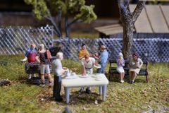 Miniature summer back yard barbeque party stock images