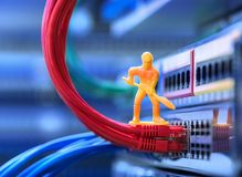 Miniature Technicians connecting network Royalty Free Stock Images