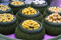 Miniature Thai dessert. A variety of Thai desserts arranged nicely in bowls made from banana leaves Royalty Free Stock Images