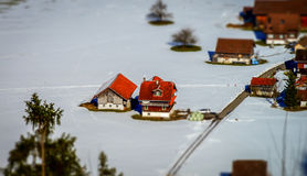 Miniature tilt-shift aerial view of the village in Alps Royalty Free Stock Photos