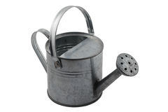 Miniature tin watering can on white Stock Photos