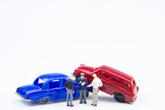 Miniature tiny toys car crash accident damaged.Insurance on the Royalty Free Stock Photos