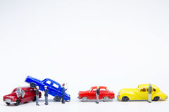 Miniature tiny toys car crash accident damaged.Insurance on the Royalty Free Stock Image