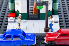 Miniature tiny toys paparazzi were taken secretly the couple. Stock Images