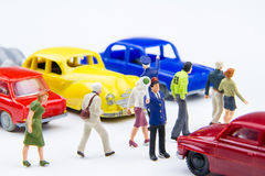 Miniature tiny toys police are standing Do not driveway for people walking crossing the street. stock photography