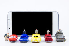 Miniature tiny toys use smartphone as a movie screen.Theme commu Royalty Free Stock Image