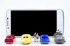 Miniature tiny toys use smartphone as a movie screen.Theme commu Royalty Free Stock Photo
