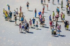 Miniature tourists Stock Images