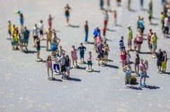 Miniature tourists Stock Images