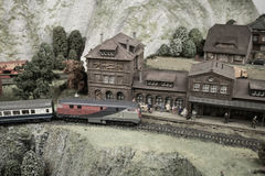 Miniature toy model of modern train crossing  town Royalty Free Stock Images