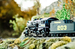 Miniature toy model train locomotives on display Stock Image