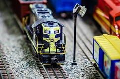 Miniature toy model train locomotives on display Stock Photography