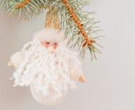 Miniature toy Santa Claus. Green ornamentation fir-tree Stock Photos