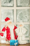 Miniature toy Santa Claus, Snow Maiden Royalty Free Stock Photo