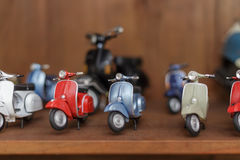 Miniature toy scooters Stock Photos