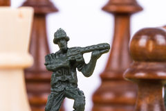 Miniature Toy Soldier on Chess Board Stock Photography