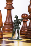 Miniature Toy Soldier on Chess Board Stock Images