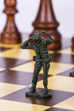 Miniature Toy Soldier on Chess Board Royalty Free Stock Image